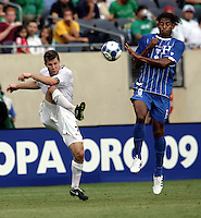 Carlo Costly (13) jumps to block a pass by Logan Pause (8).  The US Men's National Team defeated Honduras 2-0 in the semifinals of the Gold Cup at Soldier Field in Chicago, IL on July 23, 2009.