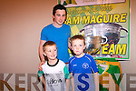 Kerry footballer, Paul Murphy, with Kieran and Timothy O'Donoghue and the Sam Maguire.