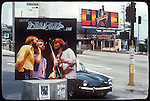 Bee Gees sign at Tower Records parking lot and billboard for Marvin Gaye over the Old World restaurant on the Sunset Strip in Los Angeles  circa 1977