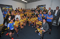 Prince Harry poses for a team photo with the Hurricanes team in the Hurricanes changing rooms after the Super Rugby match between the Hurricanes and Sharks at Westpac Stadium, Wellington, New Zealand on Saturday, 9 May 2015. Photo: Dave Lintott / lintottphoto.co.nz