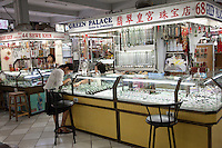 Myanmar, Burma, Yangon.  Jewelry Stands in Scott's Market.  Chinese Writing in Store's Sign.