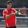 Eli Grossman of Syosset returns a volley during the Nassau County varsity boys tennis doubles final at Oceanside High School on Sunday, May 21, 2017. He and doubles partner Preet Rajpal (not pictured) bested Zachary Khazzam and Sangjin Song on Roslyn 7-6, 6-2 to claim the county doubles title.
