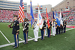 The Color Guard prepares to march onto the field for the National Anthem during the Wisconsin Badgers NCAA college football game against the San Jose State Spartans on September 11, 2010 at Camp Randall Stadium in Madison, Wisconsin. The Badgers beat San Jose State 27-14. (Photo by David Stluka)