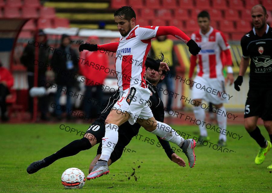 Fudbal Jelen Super League season 2015-2016<br /> Crvena Zvezda v Vozdovac<br /> Hugo Oliveira Vieira (L) and Marko Adamovic<br /> Beograd, 28.11.2015.<br /> foto: Srdjan Stevanovic/Starsportphoto&copy;