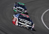 Oct. 10, 2009; Fontana, CA, USA; NASCAR Nationwide Series driver Jason Leffler leads Brian Scott during the Copart 300 at Auto Club Speedway. Mandatory Credit: Mark J. Rebilas-