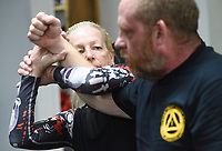 """Susa Johnson of McCalister, Okla. (left) performs a silat self-defense maneuver on Matthew Campbell of Wilburton, Okla. (right)., Saturday, June 20, 2020 at Integrated Combat Systems NWA in Fayetteville. Instructors provided a four hour silat seminar for combat enthusiasts and people interested in self-defense. Silat is an Indonesian form of martial arts involving empty hand combat, grappling and bladed fighting. """"Unlike other martial arts, everything is trained concurrently. You apply the same concepts with empty hands as with weapons. It's a more streamlined process of learning how to fight and defend yourself,"""" said Diem Ngu, owner and instructor. Check out nwaonline.com/200621Daily/ for today's photo gallery. <br /> (NWA Democrat-Gazette/Charlie Kaijo)"""