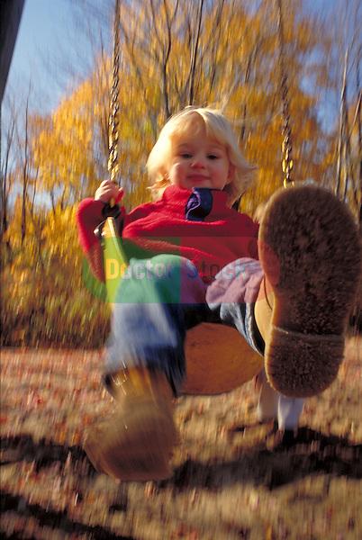 young girl swinging