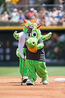 Charlotte Knights mascot Homer the Dragon runs the bases with his dad on Father's Day between innings of the International League game against the Indianapolis Indians at BB&T BallPark on June 19, 2016 in Charlotte, North Carolina.  The Indians defeated the Knights 6-3.  (Brian Westerholt/Four Seam Images)