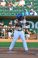 Justin Chigbogu (50) of the Ogden Raptors at bat against the Great Falls Voyagers in Pioneer League action at Lindquist Field on July 17, 2014 in Ogden, Utah.  (Stephen Smith/Four Seam Images)
