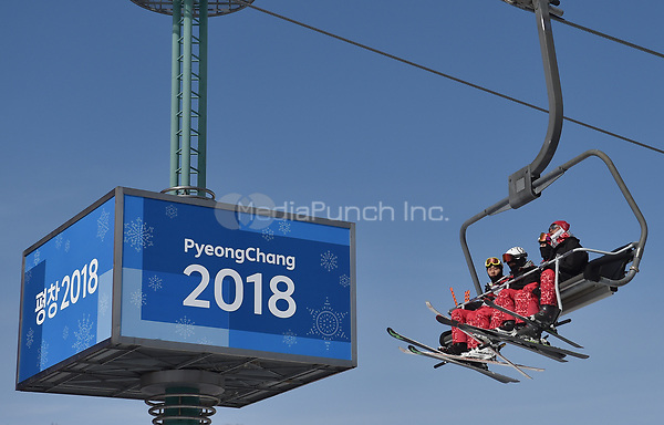 Helpers sitting on a lift in the Olympic Phoenix Snow Park in Pyeongchang, South Korea, 07 February 2018. The Pyeongchang 2018 Winter Olympics take place between 09 and 25 February. Photo: Angelika Warmuth/dpa /MediaPunch ***FOR USA ONLY***