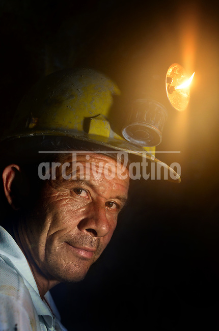 Marmato, Caldas state, Colombia, a dramatic case of environmental destruction due the work of illegal gold miners that process tons of rocks using hazardous chemical at the open, and throwing the contaminated mud into the rivers of the place<br /> A miner shows a carbide lamp