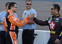 Apr 19, 2007; Avondale, AZ, USA; Nascar Nextel Cup Series driver Tony Stewart (20) embraces Juan Pablo Montoya (42) during qualifying for the Subway Fresh Fit 500 at Phoenix International Raceway. Mandatory Credit: Mark J. Rebilas