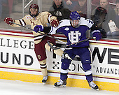 Matthew Gaudreau (BC - 21), Tim Driscoll (HC - 22) - The visiting College of the Holy Cross Crusaders defeated the Boston College Eagles 5-4 on Friday, November 29, 2013, at Kelley Rink in Conte Forum in Chestnut Hill, Massachusetts.