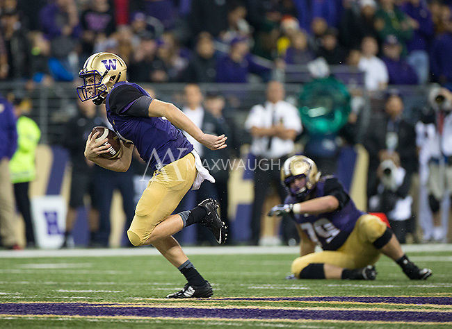 Jake Browning scrambles into the clear.