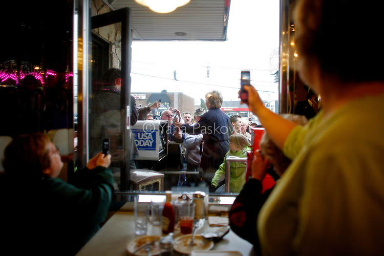 Potential supporters of U.S. Presidential hopeful Hillary Clinton (D-NY) cheer for her and take pictures as she arrives to a roundtable discussion at the Capitol Diner in Harrisburg, Pennsylvania, on Monday, March 31, 2008. The Senator is hoping to woo crucial to her votes in the state before its primary on April 22, 2008. (Photograph by Yana Paskova for Newsweek)