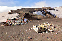 A ruined building and boat in Whalers Bay on Deception Island are artifacts from the whaling era in the Antarctic Seas.  Deception Island is part of the South Shetland Islands, near the Antarctic Peninsula.