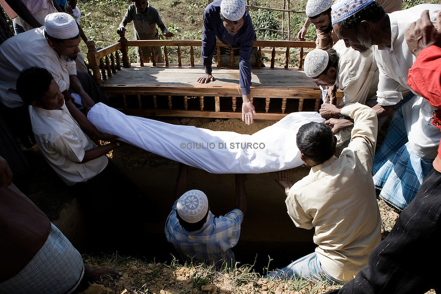 Rohingya refugees attend a funeral in the unofficial Kutuplanong refugee camp, Cox's Bazar, Bangladesh.
