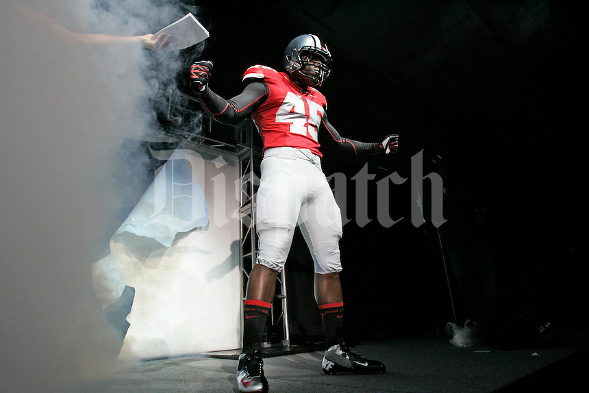 Raymont Harris debuts the new Buckeye uniform during the Beat Michigan Pep Rally at the Archie M. Griffin Ballroom of the Ohio Union in Columbus, OH, on Monday, November 19, 2012. (The Columbus Dispatch / Thomas Levinson)