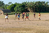 Pará State, Brazil. Aldeia Apyterewa (Parakana). Girls playing football.