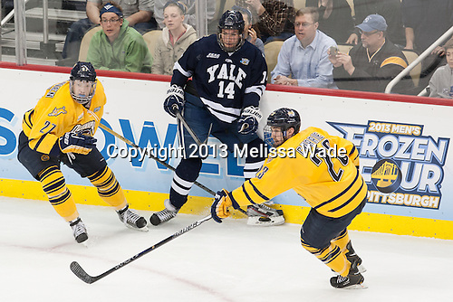 Zach Tolkinen (QU - 27), Ryan Obuchowski (Yale - 14), Zack Currie (QU - 23) - The Yale University Bulldogs defeated the Quinnipiac University Bobcats 4-0 in the 2013 Frozen Four final to win the national championship on Saturday, April 13, 2013, at the Consol Energy Center in Pittsburgh, Pennsylvania.