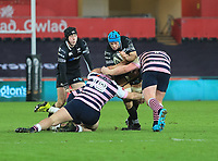Ospreys' Justin Tipuric is tackled by Cardiff Blues' Dillon Lewis and Rhys Gill.<br /> <br /> Photographer Dan Minto/CameraSport<br /> <br /> Guinness Pro14 Round 13 - Ospreys v Cardiff Blues - Saturday 6th January 2018 - Liberty Stadium - Swansea<br /> <br /> World Copyright &copy; 2018 CameraSport. All rights reserved. 43 Linden Ave. Countesthorpe. Leicester. England. LE8 5PG - Tel: +44 (0) 116 277 4147 - admin@camerasport.com - www.camerasport.com