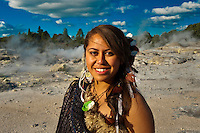 A young Maori woman (with the Pohutu Geyser behind), Te Puia (New Zealand Maori Arts & Crafts Institute), Rotorua, New Zealand