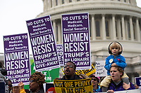 Demonstrators hold up protest signs in front of the United States Capitol during a rally led by United States Congressional Democrats against United States President Donald J. Trump's proposed tax plan outside the United States Capitol in Washington, D.C. on November 1st, 2017.<br /> Credit: Alex Edelman / CNP /MediaPunch