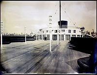 BNPS.co.uk (01202 558833)<br /> Pic:    CanterburyAuctionGalleries/BNPS<br /> <br /> A view of the First Class terrace.<br /> <br /> Remarkable photos of the iconic ocean liner SS Normandie which was like a 'floating palace' have come to light over 80 years later.<br /> <br /> The giant 1,000ft long French passenger ship was the largest of her type in the world and won the coveted 'Blue Riband' for the fastest crossing of the Atlantic.<br /> <br /> English photographer Percy Byron's photos show the liner's luxurious 'Art Deco' interior with its chandeliers and pillars of Lalique glass.<br /> <br /> The vessel, which launched in 1935, even boasted its own swimming pool and a gym where young women can be seen doing aerobics while a man in a suit trains with a punch bag.
