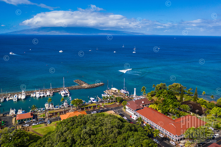 An aerial view of Maui's Lahaina Harbor, with Lana'i in the distance.