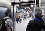 People inside an elevator in a store in Tokyo, Japan