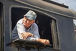 Essex, CT Steam Train excursion. Engineer at cab window.
