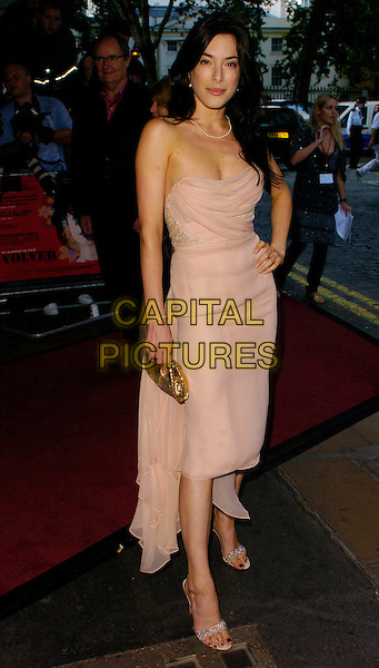 """JAIME MURRAY.""""Volver"""" UK film premiere, Curzon Mayfair, London, UK..August 3rd, 2006.Ref: CAN.full length cream stapless dress gold clutch purse.www.capitalpictures.com.sales@capitalpictures.com.©Can Nguyen/Capital Pictures"""