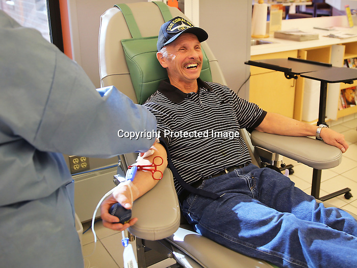 "Cheyenne resident Bob Chaput laughs while preparing to give blood at United Blood Services earlier this month. Chaput has been donating blood in Cheyenne for the past 45 years. ""Believe or not I like the weather here, it's always changing."" said Chaput about living in Cheyenne. The veteran also added ""Donating blood helps people and saves lives and that's why I do it."" To participate in WTE Photo Editor Michael Smith's 2014 Our Faces: Portraits of Laramie County project, call to make an appointment at 633-3124 or 630-8388 or email msmith@wyomingnews.com. Michael Smith/staff"