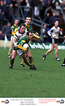 Meath's Paddy Reynolds being tackler by Ken Killieen at pairc Tailteann in Navan.Pic Fran Caffrey Newsfile.©Newsfile Ltd.