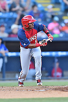 Hagerstown Suns third baseman Kelvin Gutierrez (5) squares to bunt during a game against the Asheville Tourists at McCormick Field on June 8, 2016 in Asheville, North Carolina. The Tourists defeated the Suns 10-8. (Tony Farlow/Four Seam Images)