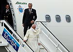 The wind knocks off Pope Francis' Zucchetto as he arrives at  Jose Marti International Airport as he is greeted by Cuban President Raul Castro in Havana, Cuba on Saturday, September 19, 2015.