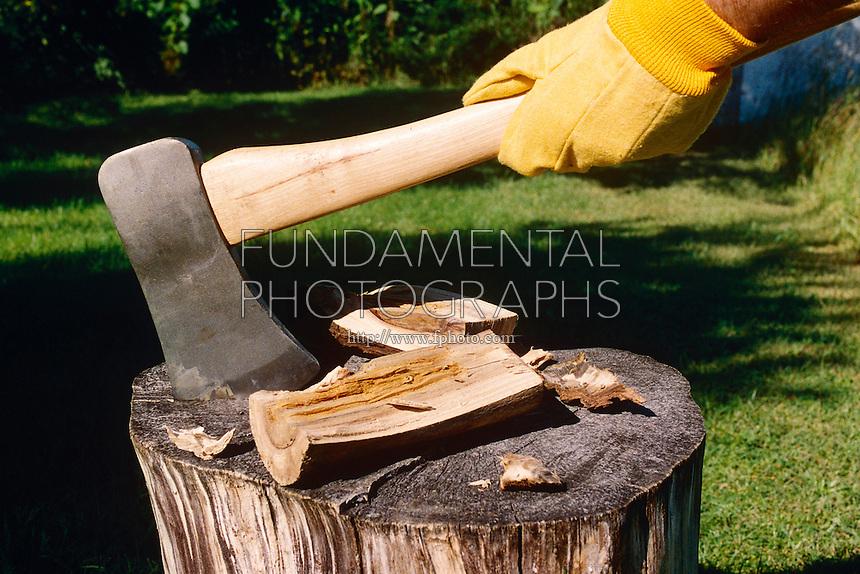 AXE SPLITTING WOOD SHOWING WEDGE<br /> Axe Splitting Wood