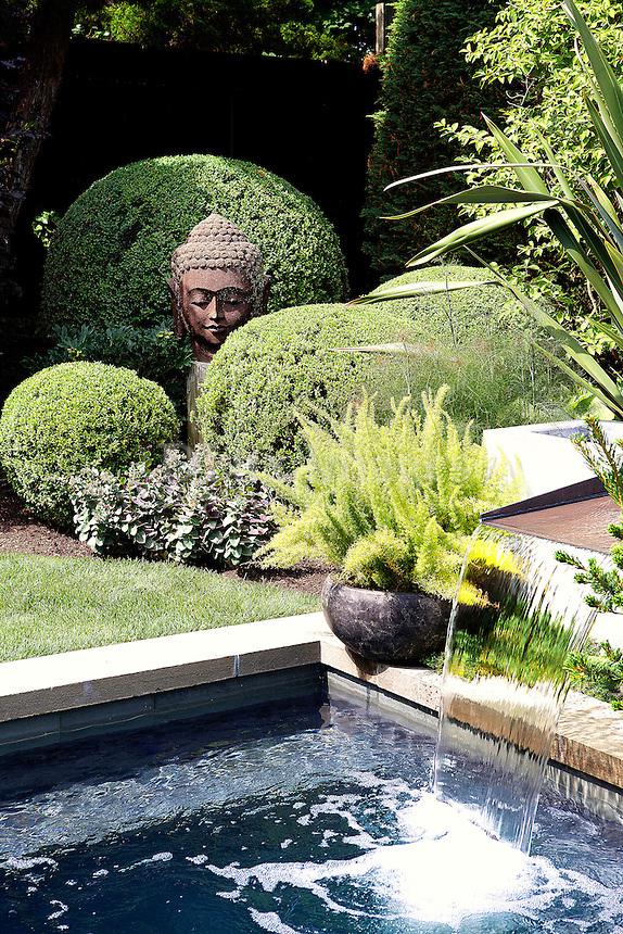 lush garden with pond