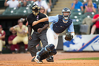 North Carolina Tar Heels catcher Cody Roberts (11) looks at the runner coming home from third base as he chases after a wild pitch during the 2017 ACC Baseball Championship Game against the Florida State Seminoles at Louisville Slugger Field on May 28, 2017 in Louisville, Kentucky.  The Seminoles defeated the Tar Heels 7-3.  (Brian Westerholt/Four Seam Images)