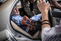 A Syrian elder civilian bawls as he points out that he has been shot by an Assad's sniper while walking on the street at Bab Al Naser neighborhood in the downtown of Aleppo City.