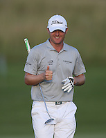 Well deserved thumbs up for Michael Hoey (NIR) who hits 7 birdies on the back nine for a card of 65 (-10) and is well placed for the tournament after  Round Two of The Tshwane Open 2014 at the Els (Copperleaf) Golf Club, City of Tshwane, Pretoria, South Africa. Picture:  David Lloyd / www.golffile.ie