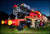 BNPS.co.uk (01202 558833)<br /> Pic: PhilYeomans/BNPS<br /> <br /> Harrison family check out the illuminated full size steam train at the Festival. <br /> <br /> As the clocks go back the lights come on at Longleat House in Wiltshire - as the hugely popular Festival of Light switches on.<br /> <br /> The English country estate is transformed with 800 illuminated lanterns to take visitors on a magical journey around the world and under the sea.<br /> <br /> Staff at the popular park attraction say this is their most ambitious event yet, with a team of highly-skilled Chinese artists spending more than 7,000 hours to complete the different stories for A Fantastic Voyage.<br /> <br /> The displays have used more than 25 miles of silk and LED lighting strips, as well as more than 60,000 light bulbs.