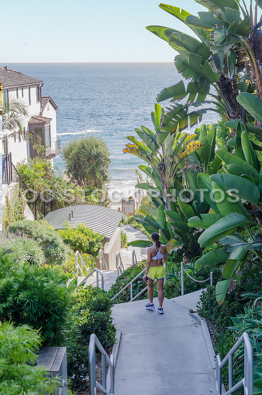 Fitness Lady walking Down the Stairs to Shaw's Cove in Laguna Beach