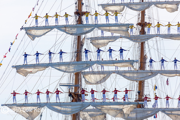 Sailors On the Yard Arms of the tall ship Gloria from Colombia in Boston Harbor, Boston, Massachusetts, USA