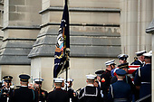 The flag-draped casket of former President George H.W. Bush is carried by a joint services military honor guard in to a State Funeral at the Washington National Cathedral, Wednesday, Dec. 5, 2018, in Washington. <br /> Credit: Alex Brandon / Pool via CNP