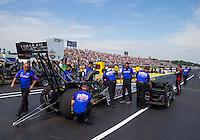 May 17, 2015; Commerce, GA, USA; Crew members make final preparations for NHRA top fuel driver Richie Crampton during the Southern Nationals at Atlanta Dragway. Mandatory Credit: Mark J. Rebilas-USA TODAY Sports
