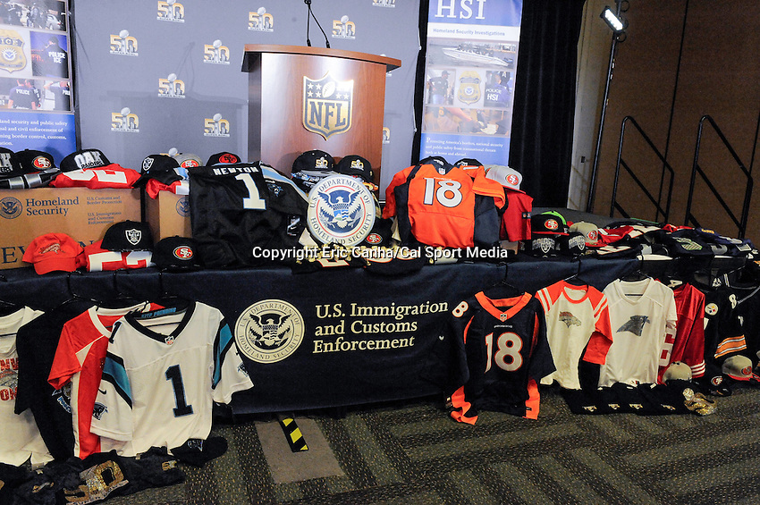 Thursday, February, 2016: The NFL and ICE display counterfeit merchandise during a press conference  at the Moscone Center, ahead of the National Football League Super Bowl 50 between the Denver Broncos and the Carolina Panthers. Eric Canha/CSM