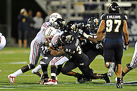 12 November 2011:  FIU linebacker Winston Fraser (34), defensive back Tevin Blanchard (29), safety Jonathan Cyprien (7) and defensive lineman Andre Pound (75) combine to stop running back Alfred Morris (32) in the second quarter as the FIU Golden Panthers defeated the Florida Atlantic University Owls, 41-7, to win the annual Shula Bowl game, at FIU Stadium in Miami, Florida.