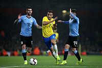 Arthur of Brazil bursts through the Uruguay defence during Brazil vs Uruguay, International Friendly Match Football at the Emirates Stadium on 16th November 2018