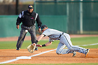 Zach Remillard (7) of the Coastal Carolina Chanticleers dives for the baseball as it bounces off of third base during the game against the High Point Panthers at Willard Stadium on March 14, 2014 in High Point, North Carolina.  The Panthers defeated the Chanticleers 3-0.  (Brian Westerholt/Four Seam Images)
